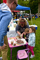 Brad Sawyerof Rochester buys cookies from Julie Brown from N. Hollow Farm assisted by Landon Harvey & Sophia Vassseur